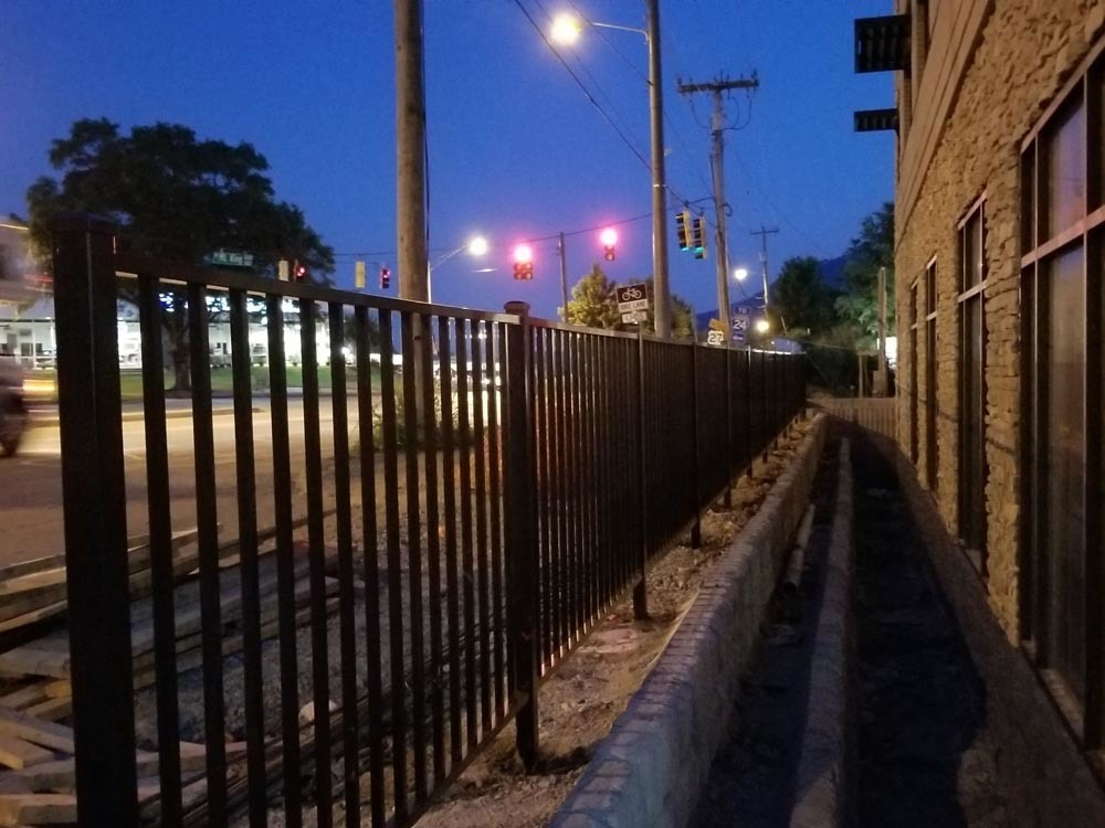 industrial black aluminum fence, nightlife